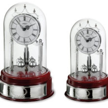 Set clocks for desktop, wood and silver, with perspex dome.