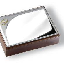 Box of silver and wood for 50 wedding anniversary, with commemorative rings.
