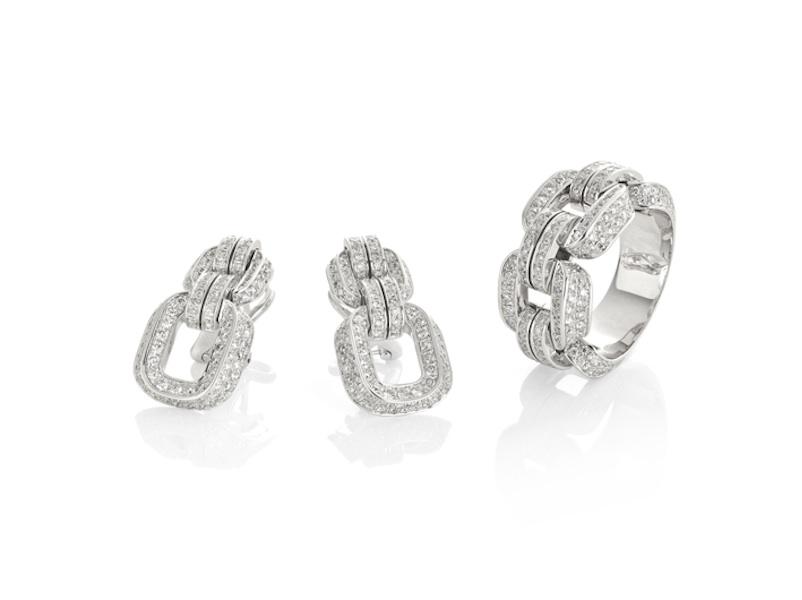 9c641926d35c Conjunto de pendientes y anillo en oro blanco y dimantes.