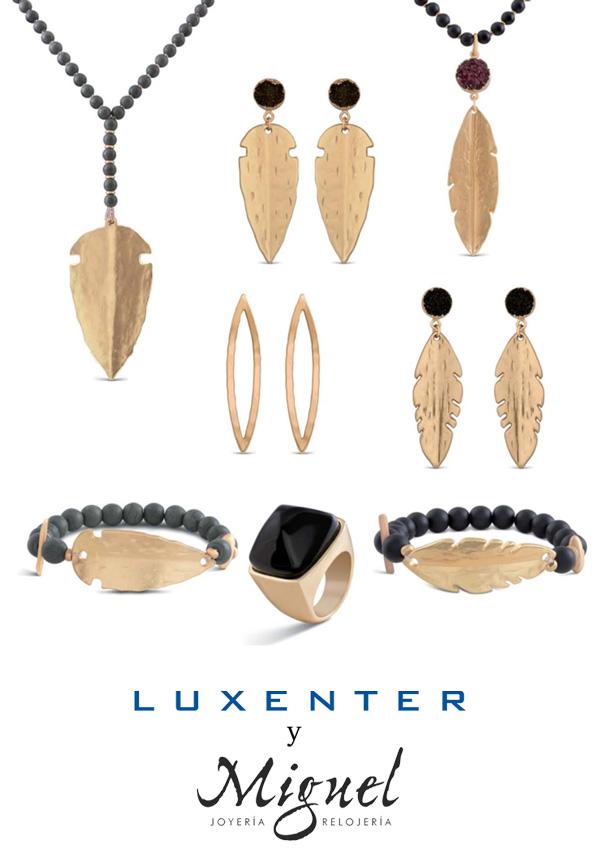 Colección Luxenter con forma de pluma/flecha, en metal dorado y negro.