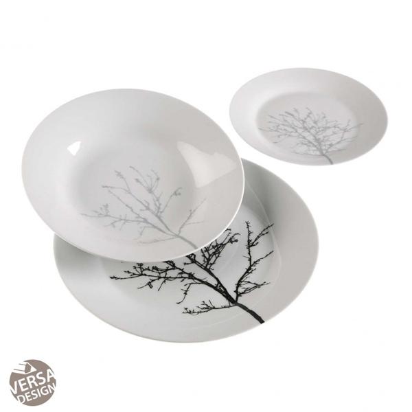 Vajilla de 18 piezas de Versa, en loza blanca, con una rama de árbol dibujada.